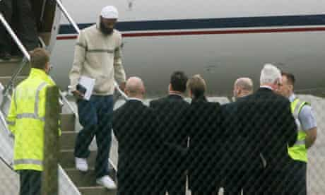 Binyam Mohamed released from Guantanamo Bay steps from a plane at Northolt.