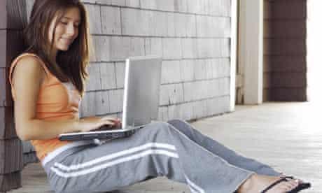 Girl using laptop outside