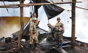 Cambodian rangers destroy a sassafras distillery