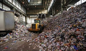 A digger moves waste at Greenstar Recycling facility at Aldridge near Walsall
