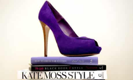 A high-heeled shoe on top of books on style