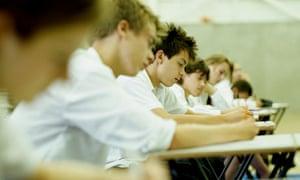 Admissions. Row of schoolchildren (12-16) at desks in exam hall
