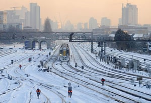 Gallery Snow updated: A train arrives at Clapham Junction station in south London