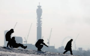 Gallery Snow updated: London: Children sledge down Primrose Hill.