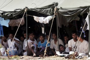 Gallery Rohingya refugees: Rohingya refugees sit in their encampment