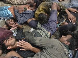Gallery Rohingya refugees:  Rohingya refugees lay sprawled on the ground