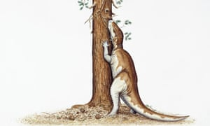 Camptosaurus dinosaur eating leaves from a tree