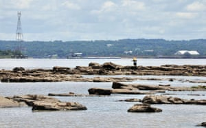 Gallery Severe Drought: Fishermen stand on stones that arose dueto severe drought