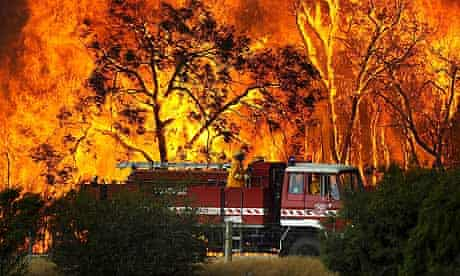 Australian firefighters tackle a bushfire at the Bunyip state forest near Tonimbuk, Victoria
