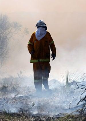 Gallery Australian fires: A firefighter surveys the damage from a bushfire