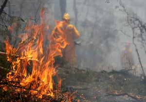 Gallery Australian fires: Firefighters are engulfed in smoke as they battle a bushfire