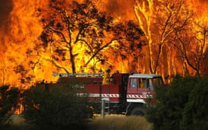 Gallery Australian fires: A fire truck moves away from an out of control bushfire