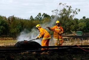 Gallery Australian bushfires: CFA vounteers hose down embers at the Yarra Glen railway station