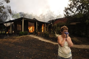 Gallery Australian bushfires: Davina Derrick watches her neighbours house burn in Drouin