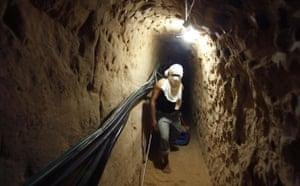 Gallery Tunnels under Gaza: Gaza tunnels Palestinian walks in a smuggling tunnel in Rafah