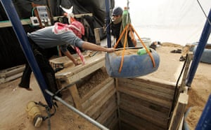 Gallery Tunnels under Gaza: Gaza tunnel Palestinians inspect and reconstruct Egypt-Gaza tunnels