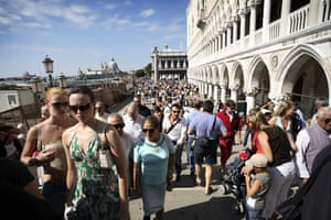 Venice in decline: Crowds of tourists on the Ponte Della Paglia, St Mark's Square in Venice.