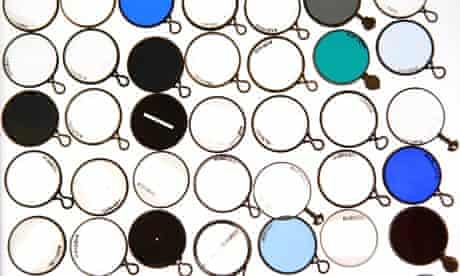 A drawer of antique optical test lenses is displayed at the Science Museum's Object Store in London.