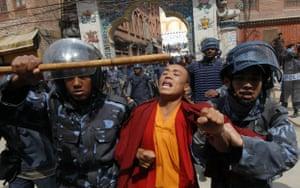 Kathmandu Uprising day: Nepalese riot police detain a Tibetan Buddhist monk in Kathmandu.