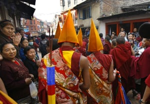 Kathmandu Uprising day: Tibetans in exile watch the procession on uprising day.