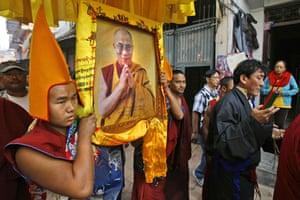 Kathmandu Uprising day: Tibetan monks carry the photograph of their spiritual leader Dalai Lama.