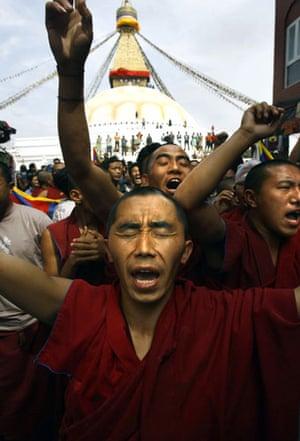 Kathmandu Uprising day: Tibetan in exile shout anti-Chinese government slogans after prayers.