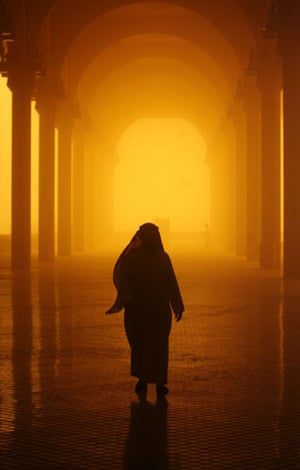 Gulf sandstorm: Saudi people walk through a sand and dust storm in Riyadh on 10 March 2009.