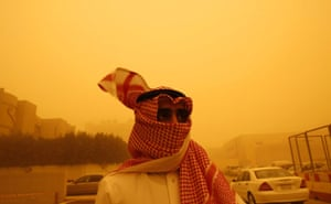 Gulf sandstorm: A Saudi man covers his face during a sandstorm.