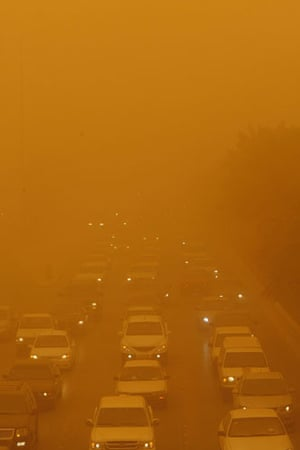 Gulf sandstorm: Cars drive along a highway as a sandstorm reduces visibility, Saudi Arabia.