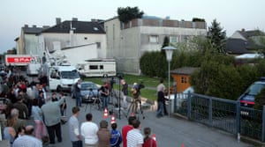 Abuse in Amstetten: Townspeople and the media gather behind Josef Fritzl's house in April 2008