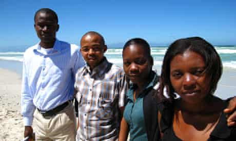 Olubode (Bode) Adetunji, left, and Marie Chantal Cyulinyana, right, with fellow Aims students