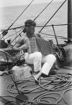 Alan Villiers: A sailor and his accordion onboard the Parma by Alan Villiers