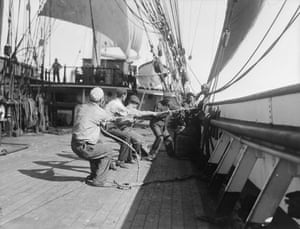 Alan Villiers: Sailors working onboard the Parma by Alan Villiers