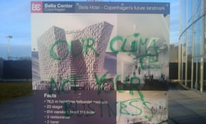 """""""Our climate, not your business"""" - a graffitied sign at a carbon trading conference in March 2009"""