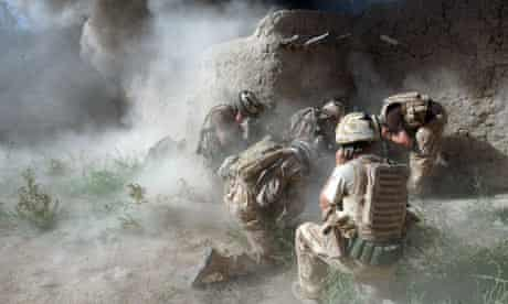 Soldiers demolish the wall of a Taliban-held compound in Helmand