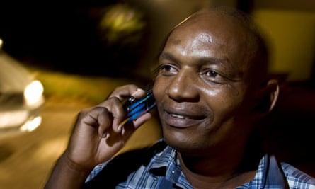 Boniface kamau on his mobile phone