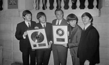 The Beatles with Alan Livingston Receiving Gold Records