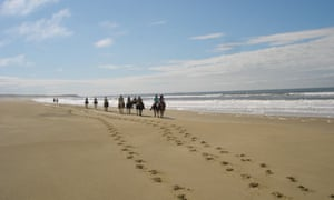 Horse riding along the beach in Uruguay