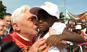 Pope Benedict XVI kissing a child in Angola