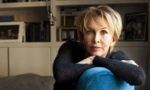 Trudie Styler sitting in a blue chair