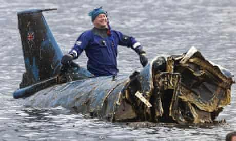 Bill Smith on top of the wreck of Donald Campbell's Bluebird