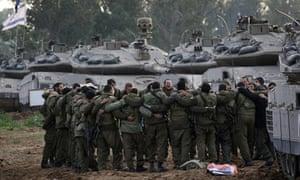 Israeli soldiers prepare to move towards northern Gaza