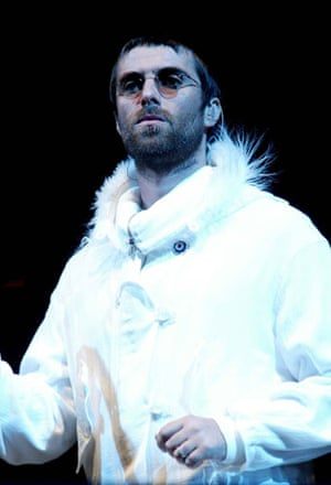 Liam Gallagher fashion: Liam in white parka with fluffly hood