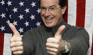 Stephen Colbert sticks his thumbs up