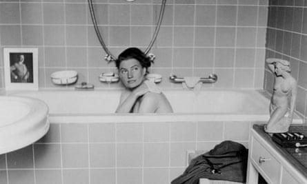 Lee Miller posing in Hitler's bathtub