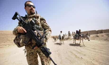soldier of patrols in the village of Madrassa near Kunduz in northern Afghanistan