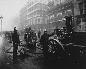 Firefighter uniforms: 1899: Firemen attending a fire on Bread Street, London
