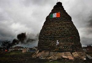 Unseen: A boy climbs on a bonfire on the Ballycraigy estate