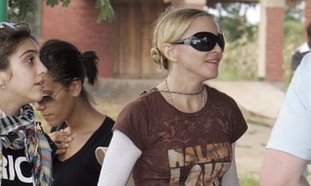 U.S. pop star Madonna and her daughter Lourdes visit a school she financed in Namitete