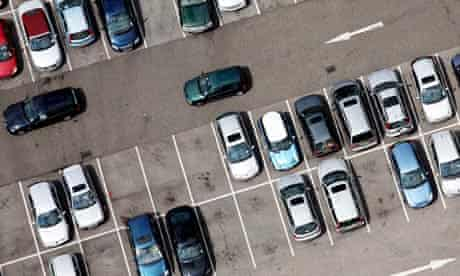 An aerial view of cars in a carpark in Brent Cross in London